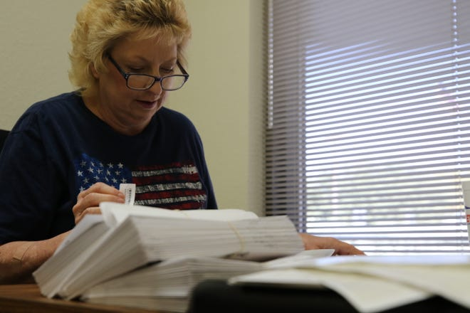 The late Eddy County Clerk Robin Van Natta on Oct. 5 at the office of the Eddy County Clerk works to label absentee ballots to be mailed Oct. 6 to area voters. Van Natta died March 16, 2021 at Carlsbad Medical Center.