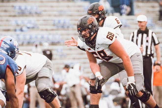 Oklahoma State redshirt freshman Taylor Miterko (68) faces off against Kansas for his first college game experience on Saturday, October 3, 2020. Miterko graduated from Carlsbad High in 2019.