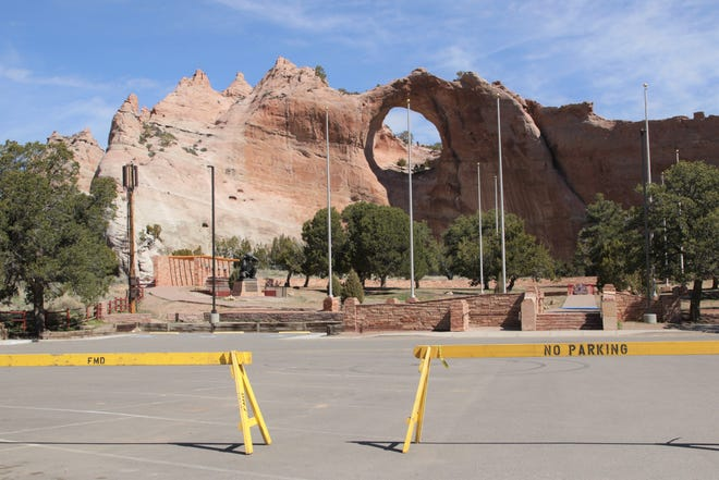 Barricades sit in the parking lot at the Veterans Memorial Park on March 29, 2020 in Window Rock, Arizona. The Navajo Parks and Recreation Department is keeping the park and other locations closed until 2021.