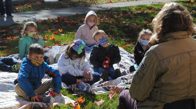 "Children enjoying ""a day at the orchard"" outside Mother Hubbard in October 2020."