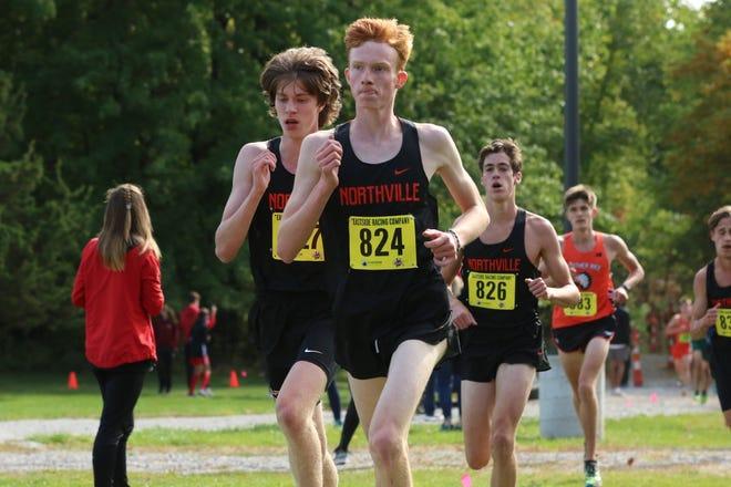 Senior Zach Helner (front), sophomore Brandon Latta, (left) senior Matthew Krahe and senior Max Uphaus compete at the Hansons Invitational.