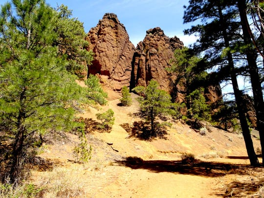 The Red Mountain Trail north of Flagstaff skirts past colorful hoodoos, twisted pillars and gnawed spires.