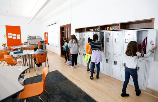 Fifth-grade students at Sunshine Elementary fill their lockers on the first day of classes at the newly renovated school on Monday, Oct. 5, 2020. The nearly $14 million project was funded by the $168 million bond issue approved by voters in April 2019.