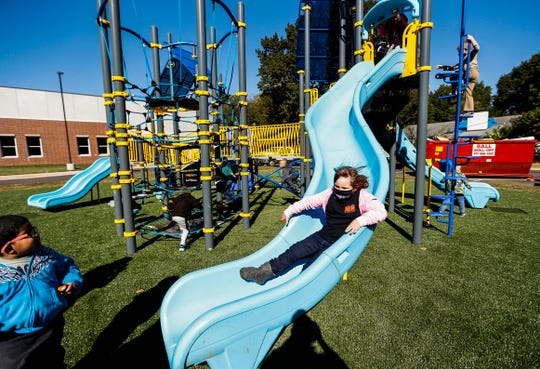 Kindergarten students test out the new playground equipment at the newly renovated Sunshine Elementary on Monday, Oct. 5, 2020.