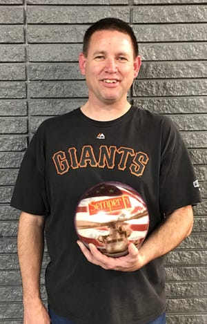 Russ Harkins, a St. George resident and Marine, fired a total of 26 strikes in a 758 series (on games of 278, 270 and 210) at Dixie Bowl last week as his team won all three games.