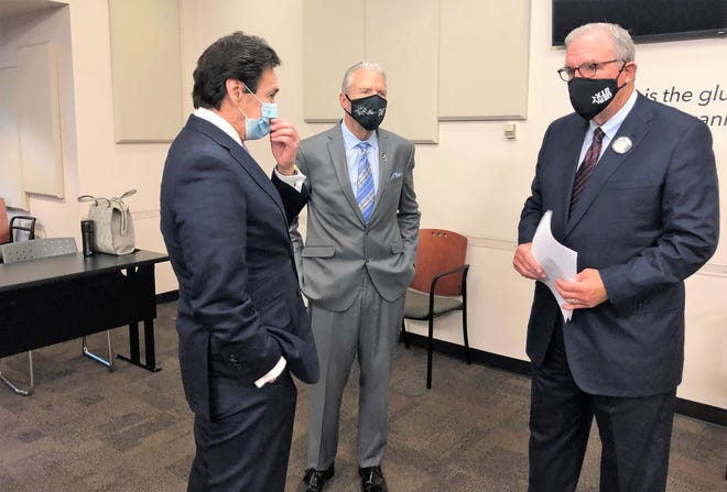 Borderplex Alliance CEO Jon Barela, left, County Judge Ricardo Samaniego, center, and El Paso Mayor Dee Margo talk after an Oct. 5, 2020, news conference announcing that TJX Companies plan to build a $150 million warehouse/distribution center in East El Paso.