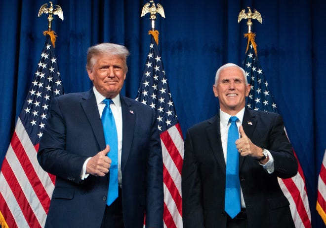 President Donald Trump and Vice President Mike Pence attend the first day of the Republican National Convention on Oct. 2, 2020.