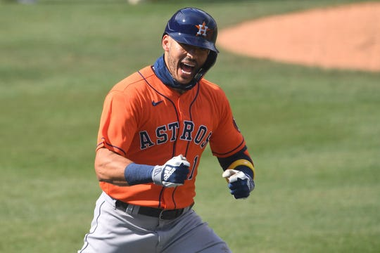 Carlos Correa celebrates his two-run home run in the fourth inning.