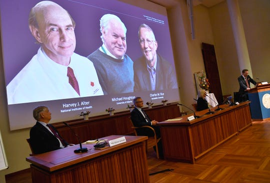 Thomas Perlmann, far right, Secretary of the Nobel Assembly announces the 2020 Nobel laureates in Physiology or Medicine during a news conference at the Karolinska Institute in Stockholm, Sweden, Monday Oct. 5, 2020.