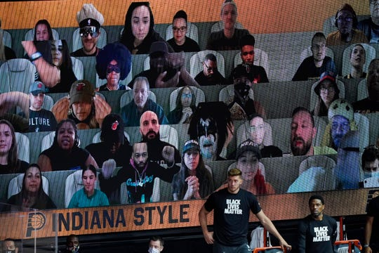Virtual fans are seen during a playoff game between the Miami Heat and the Indiana Pacers.