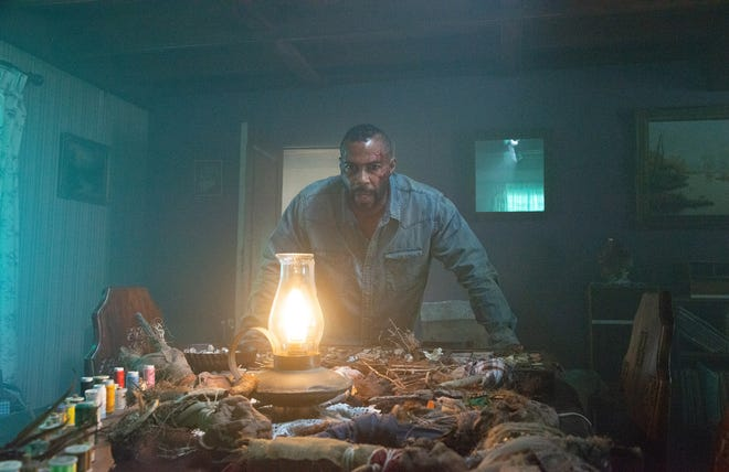 "Omari Hardwick stars as a man who wakes up after a plane crash and realizes he's the subject of some serious hoodoo in ""Spell."""