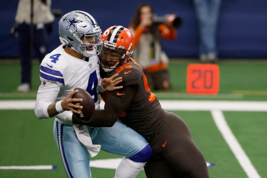 Dallas Cowboys quarterback Dak Prescott (4) is sacked by Cleveland Browns defensive end Myles Garrett (95) during the first half of an NFL football game in Arlington, Texas, Sunday, Oct. 4, 2020.