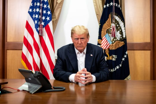 President Donald J. Trump participates in a phone call with Vice President Mike Pence, Secretary of State Mike Pompeo, and Chairman of the Joint Chiefs of Staff Gen. Mark Milley Sunday, Oct. 4, 2020, in his conference room at Walter Reed National Military Medical Center in Bethesda, Md. Not shown in the photo also in the room on the call is Chief of Staff Mark Meadows. (Official White House Photo by Tia Dufour)