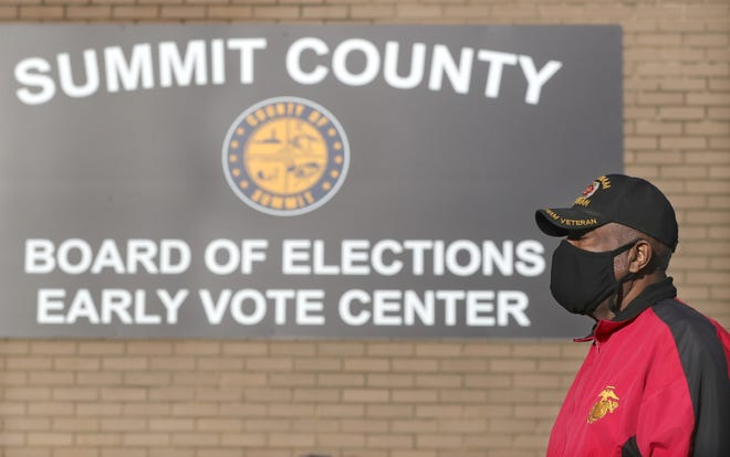 Wilbert Owens waits to vote early at the Summit County Board of Elections on Oct. 6. It's unlikely any voters will be turned away in November for not wearing a mask.