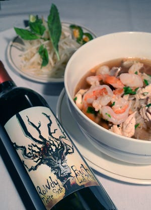 A glass of Rowdy Bush petite sirah pairs exceptionally well with a bowl of Chef Siamone Fryer's pfo combo at Wise Guys Lounge & Grill in Akron.