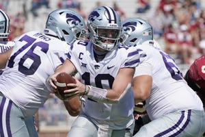 Kansas State quarterback Skylar Thompson looks for space to run during the Wildcats' win over Oklahoma in September. [Sue Ogrocki/The Associated Press]