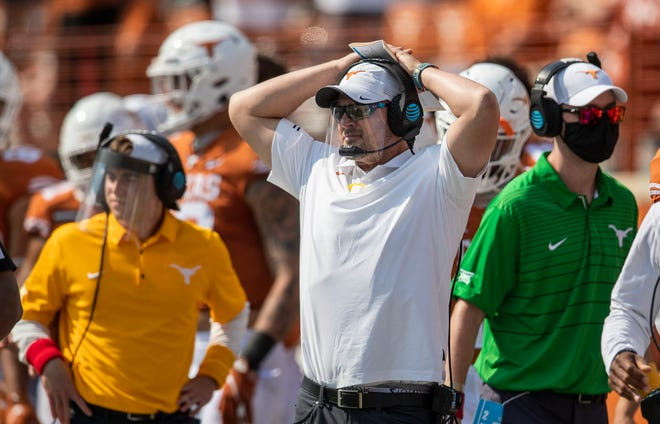 Texas Longhorns head coach Tom Herman looks on during the first half against TCU Horned Frogs of an NCAA college football game Oct 3, 2020; Austin, Texas, USA;  at Darrell K Royal-Texas Memorial Stadium.