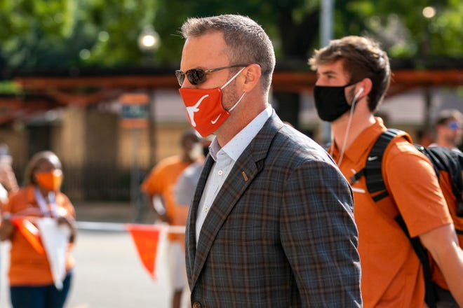 Texas head coach Tom Herman enters Darrell K. Royal Memorial Stadium before an NCAA football game between Texas and UTEP, Saturday, Sept., 12, 2020.