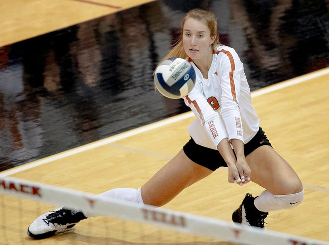 Texas setter Ashley Shook (9) passes the ball during an NCAA volleyball match against Iowa State on Wednesday, Sept. 25, 2019, in Austin, Texas. [NICK WAGNER/AMERICAN-STATESMAN]