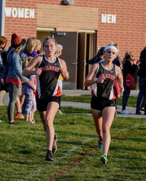 Abby McGuire (left) and Sophie Vanderpool both placed in the top five for Gilbert in the girls' race at the North Polk Invitational cross country meet Monday in Alleman. The duo has the Gilbert girls surging. The Tigers came in second as a team at Alleman.
