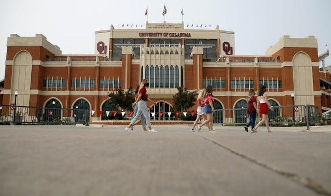 Fans walk past Gaylord Family-Oklahoma Memorial Stadium before a football game between the University of Oklahoma and Missouri State in Norman on Sept. 12.