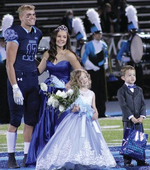 Bartlesville High School defensive back Devon Beck, left, was King for a night during last week's Homecoming game at Custer Stadium. Camden Cotner wore the Queen's mantle. The prize bearers were Abby Watson and Ky Long.