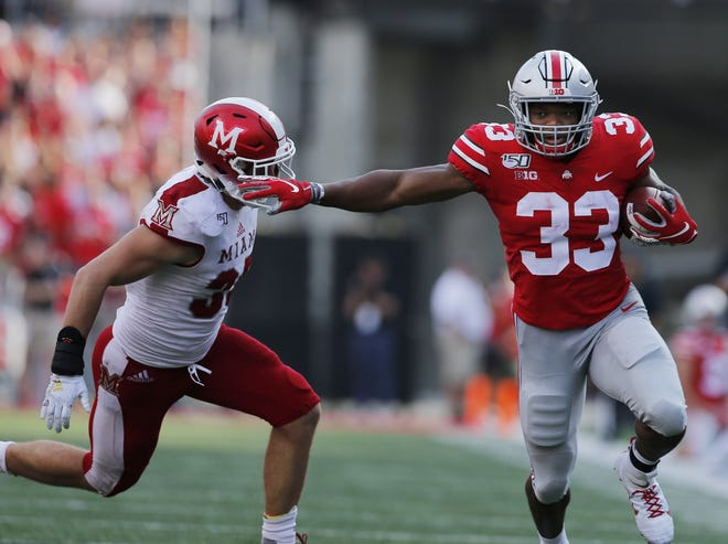 Ohio State running back Master Teague III, shown scoring on a run against Miami University last season, is recovering from an Achilles tendon injury suffered in spring practice in March. [Eric Albrecht/DIspatch]
