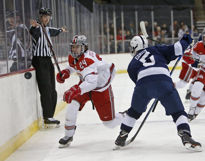 Ohio State defenseman Ryan O'Connell (24) chases the puck against Penn State's Kevin Kerr (5) in a Big Ten hockey game in 2019. [Eric Albrecht/Dispatch]