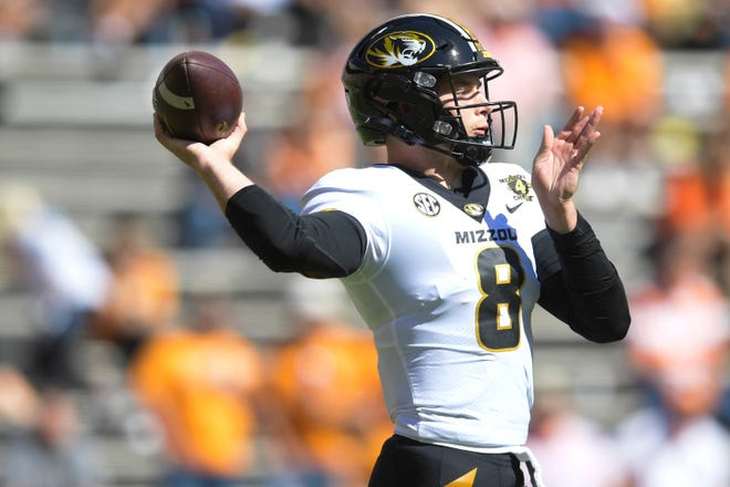 Missouri quarterback Connor Bazelak (8) throws a pass downfield during a game against Tennessee on Saturday at Neyland Stadium in Knoxville, Tenn.