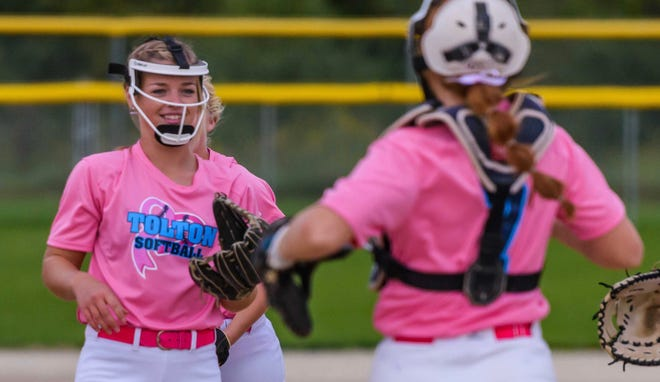 Tolton senior pitcher Paige Bedsworth, left, smiles as teammates rush to congratulate her after her 1,000th career strikeout during a game against New Bloomfield on Sept. 29 at American Legion Park.