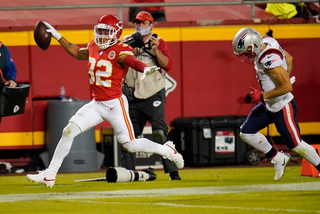 Kansas City Chiefs safety Tyrann Mathieu (32) runs from New England Patriots wide receiver Julian Edelman, right, while returning an interception 25-yards for a touchdown during the second half of a game Monday at Arrowhead Stadium in Kansas City.
