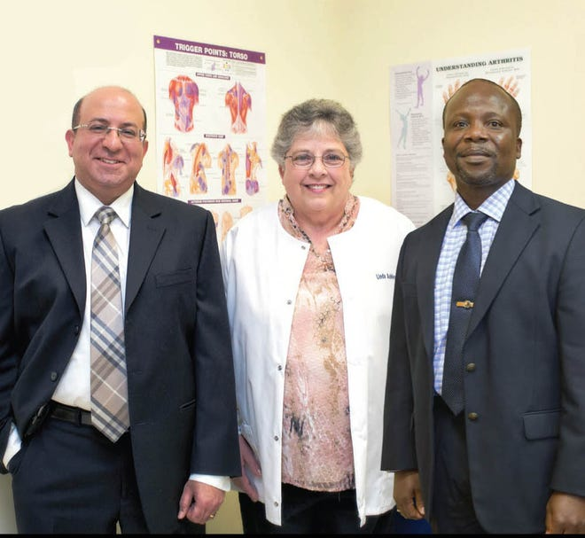 From right, Dr. Edward Tackey joins Linda Ashley, FNP, and Dr. Maged Hosny at Rheumatology Center of Delaware.