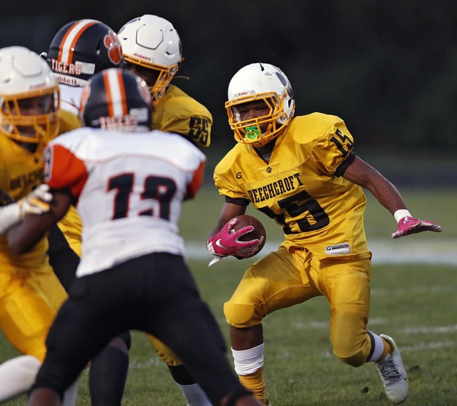 Diante Lathem (15), running against East, and the rest of the Beechcroft Cougars play at Hamilton Township on Friday night.