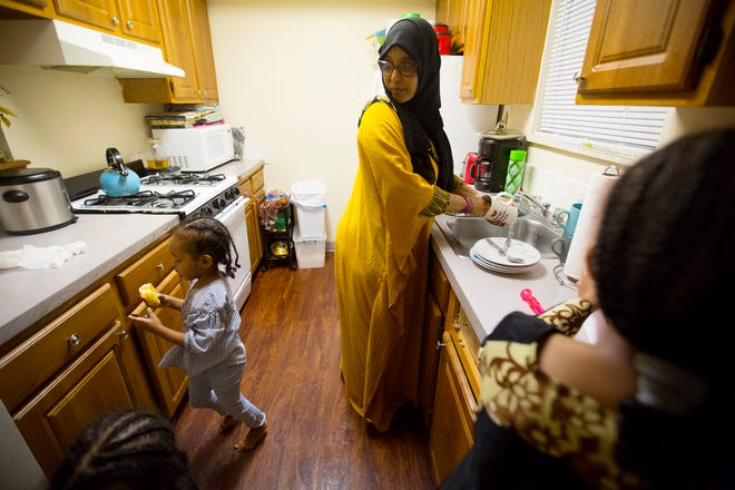Amina Olow tends her four youngest children at their Far West Side home on Feb. 11. She and her husband, Abdirahman Ibrahim, both Somali natives, were resettled in the United States in 2014 as refugees but their two oldest daughters still live in Kenya with family.