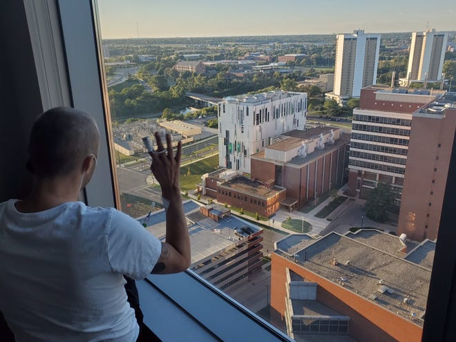 Shayne Stevens, 37, has stage 4, or late-stage sarcoma, that has mestastasized to his lungs. During his most recent hospitalization at Ohio State University's James Cancer Hospital in September, his family held up a homemade sign from the top of a parking garage to help cheer him up.