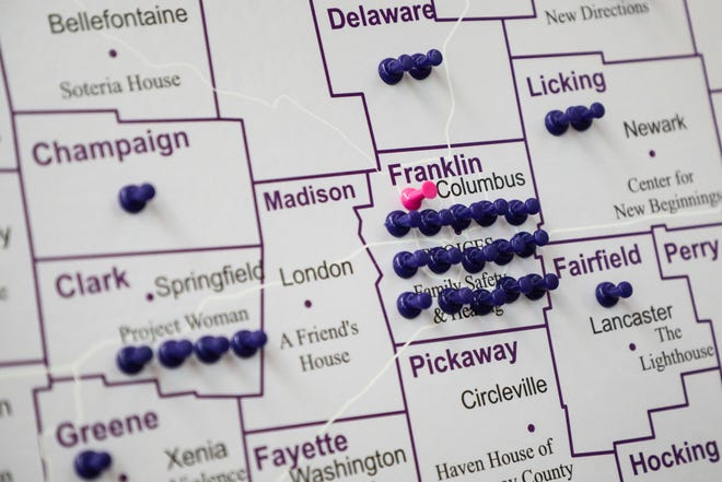 Push pins in a map of Ohio represent victims killed in domestic violence incidents during an Ohio Domestic Violence Network Domestic Violence Awareness Month presentation on Oct. 10, 2018 at the Ohio Statehouse in Columbus. A new federal grant to several Franklin County agencies aims to held reduce that.