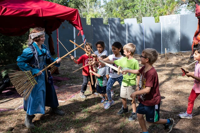 A gypsy fights off a horde of kids with swords at the Lady of the Lakes Renaissance Faire on Friday, Nov. 1, 2019. [Cindy Peterson/Correspondent]