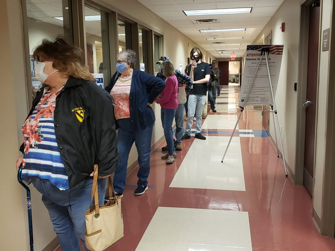 Guernsey County residents practiced social distancing while waiting in line for early voting Tuesday at the Guernsey County Board of Elections in Cambridge.