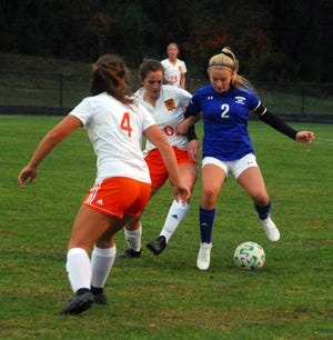 Cambridge''s Riley Crupper (2) fights for control of the ball during Tuesday's ECOL soccer match with visiting Marietta High. No results from the match were available at press time.