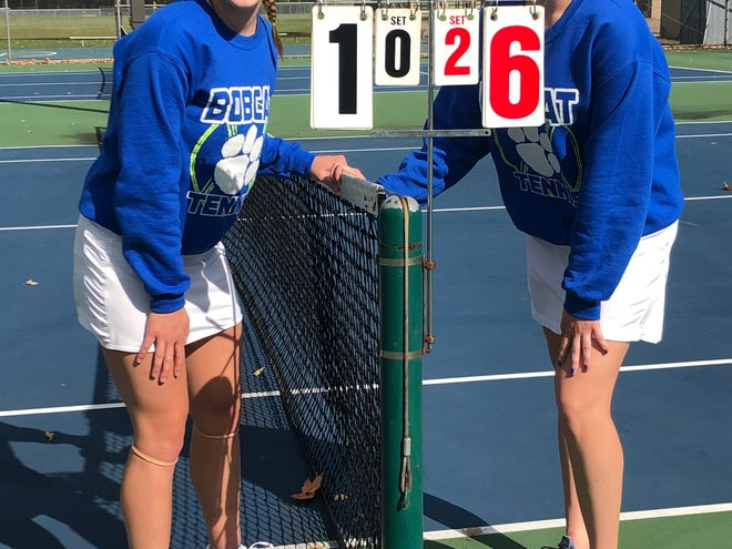 Cambridge High's first doubles team of Ziciah Gibson, left, and Kara Loader are shown following Monday's sectional tennis tournament at Dover Park. Gibson and Loader qualified for the district tournament by compiling a perfect 2-0 record at the sectional tournament.