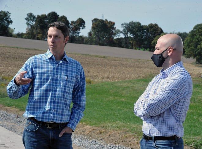 Local farmer Logan Rohr talks about his new business venture Honeytown Meats with Congressman Anthony Gonzalez, representative for Ohio's 16th district, Tuesday afternoon.