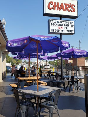 Customers take advantage of the mild 70 degree weather on Oct. 6 to eat outside on Char's new patio seating option.