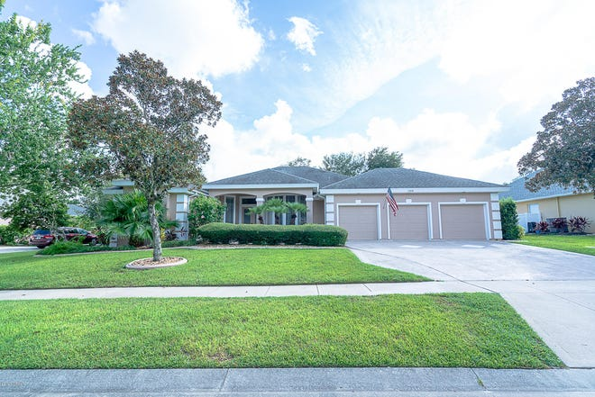 This updated ICI home offers beautiful sunsets over a lake behind its beautifully landscaped nearly half-acre lot in Port Orange.