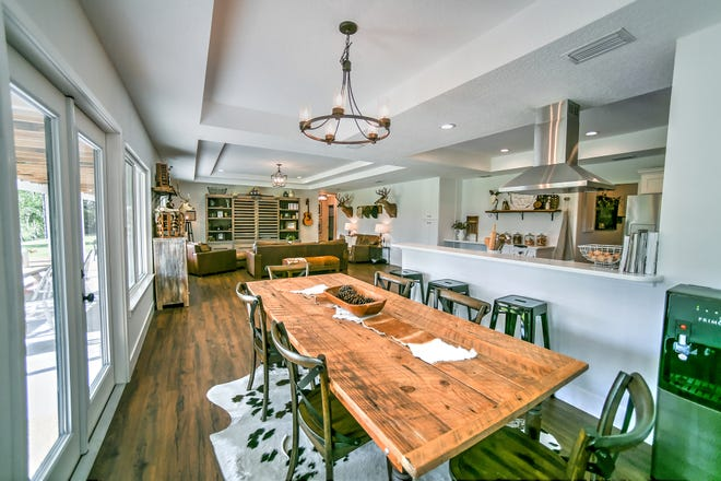 This Ormond Beach home's more than 2,300 square feet of living space features an open-floor plan, covered in luxury vinyl-plank wood-like flooring – from the dining room to the fully remodeled kitchen, with stainless-steel appliances, white cabinets, quartz countertops and a breakfast bar.
