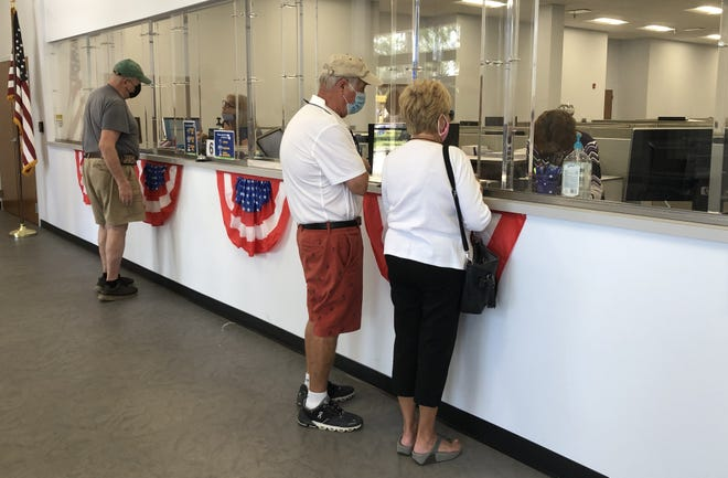 The Volusia County Supervisor of Elections Office in DeLand was busy Tuesday afternoon, with voters requesting and dropping off absentee ballots and others registering to vote last minute, as the deadline was extended on Tuesday.