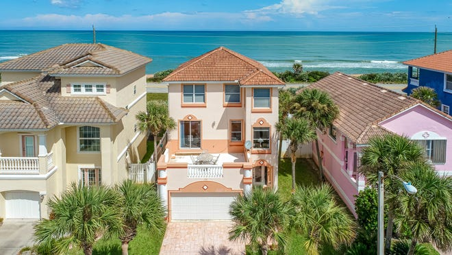This amazing direct oceanfront home on Ormond Beach's Coquina Key Drive has wrap-around ocean views and an unbelievable price of under $800,000.