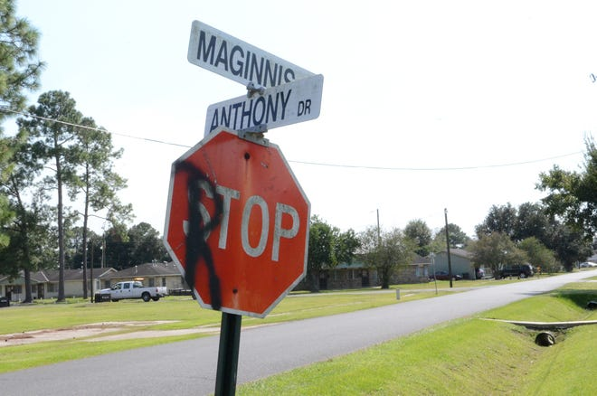 Graffiti marks a stop sign at the corner of Anthony Drive and Maginnis in Donaldsonville. An 18-year-old woman died after a shooting at a residence on Anthony Drive Sept. 30.