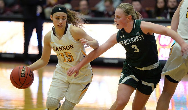 Gannon's Boston McKinney drives past Mercyhurst's Emily Shopene in the first quarter of a PSAC West women's game Feb. 12, 2020, at Gannon's Hammermill Center in Erie. Gannon and Mercyhurst were among the schools that said they plan to have their winter teams compete despite the PSAC canceling winter sports championships. [JACK HANRAHAN/ERIE TIMES-NEWS]