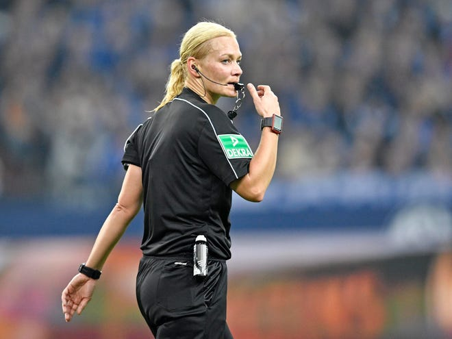 Referee Bibiana Steinhaus blows the whistle during a 2017 German Bundesliga soccer match between FC Schalke 04 and FSV Mainz 05 at the Arena in Gelsenkirchen, Germany. Steinhaus, one of the most decorated referees in women's soccer and the first female referee in the German men's Bundesliga, has announced her retirement.