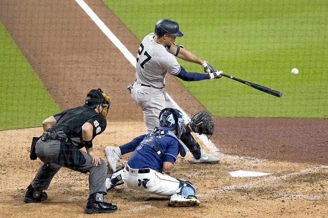 New York Yankees designated hitter Giancarlo Stanton connects for a grand slam against the Tampa Bay Rays during the ninth inning of Game 1 of their American League Division Series Monday in San Diego. [GREGORY BULL / AP]